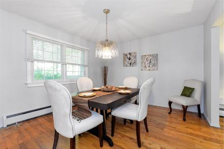 After: Showing hardwood flooring in a dining room will attract buyers