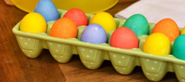 close up of colored Easter eggs on an antique table