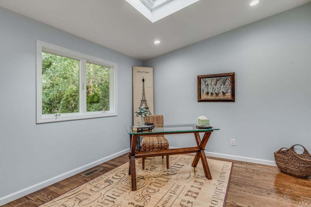 a bonus room staged as an office in Roslyn Heights NY