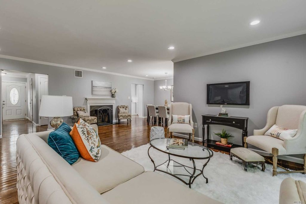 Open Concept Living room, Fireplace and Dining Area