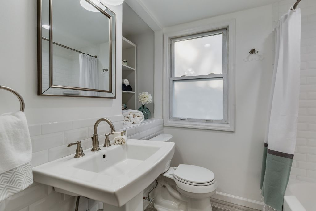 Upstairs bath staged Peachtree Lane in Roslyn Heights NY